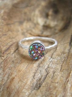 Gorgeous, peacock druzy quartz stone is set inside a petite rhodium plated sterling silver hammered ring band (rhodium plated sterling silver has