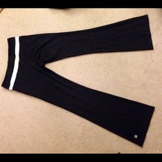 Lulu lemon reversible yoga pants Reversible yoga pants: white stripe on waistband on one side, solid black on the other. Lulu logo on pant leg on both sides! Super stretchy and comfy. Loooong inseam, I don't think these were ever tailored lululemon athletica Pants
