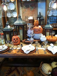 Adorable Pottery Barn Halloween table.  I love all the uses with mason jars.