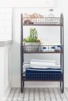 Master Bathroom Reveal - Parent's Edition - The Lilypad Cottage. Cute little cart and accessories from World Market.