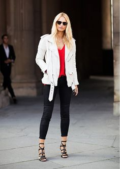 White leather jacket, red top, black cropped jeans, and strappy heels