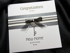 Kensington Black is a stylish & chic handmade new home card. This card features two colour schemes and features a beautiful metal key charm.The key is suspended from a beautifully double hand tied ribbon, sat above a banded purple and white sparkle board. Welcome Home Cards, New Home Cards, House Of Cards, Card Making Inspiration, Making Ideas, Congratulations New Home, Congrats Cards, New Home Greetings, Housewarming Card