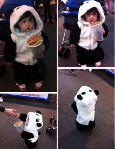 cute asian little girl in panda costume