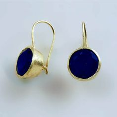 Subtle elegance of Betty Carre's brushed 18k gold overlay against rich midnight blue of faceted sapphire is so appealing. Handmade in Brazil.