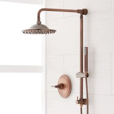 The Bostonian Rainfall Shower System allows you to transform you current shower with a more versatile luxurious experience. This shower set includes a tubular height- adjustable hand shower and an overhead rainfall shower head. A hose on the hand s Rain Shower System, Shower Systems, Bronze Shower Head, Rainfall Shower, Shower Arm, Bathroom Shower Faucets, Copper Bathroom, Bathroom Hardware, Modern Bathroom