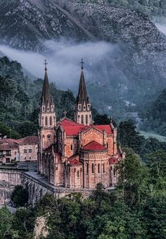 Our Lady of Covadonga, Covadonga, Asturias province, northwestern Spain. Spain is a country of contrasts: The sanctuary of Covadonga in Asturias is tucked away in an stunning setting in a narrow valley surrounded by fairy-tale mountains and glacial lakes. Places Around The World, The Places Youll Go, Great Places, Places To See, Around The Worlds, Beautiful World, Beautiful Places, Magic Places, Asturias Spain