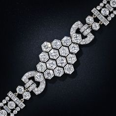 Art Deco Platinum Diamond Bracelet. Love! 21.00 carat total diamond weight, circa 1930.