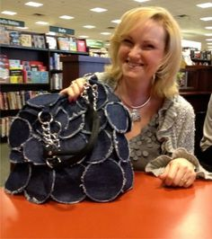 My friend Gail showing off the adorable purse she designed! Gail sells PDF patterns for many of her designs at http://www.etsy.com/shop/GailaDesigns?ref=top_trail - great ideas for friends who love to sew!