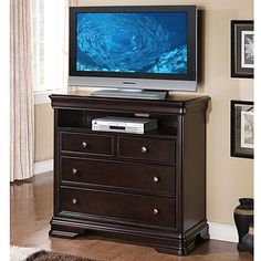 Hardwood and cherry veneers Rich espresso finish English dovetail drawer construction Full extendable drawer glides Generous storage Wire management holes