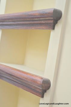 Using Stair Tread Nosing as Finishing Trim on Built-in Shelves. Creating A Home With Love Logic and Laughter - DIY Between the Studs Built-In.
