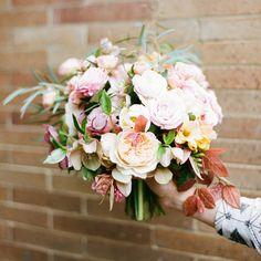 hellebore, tulip, freesia, garden rose, spray rose, eucalyptus and loropetalum foliage bouquet by Tulipina
