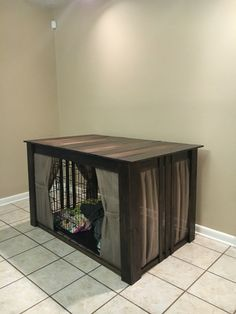 Dog crate cover! We made it from unfinished pine wood from Home Depot. Stain color Kona