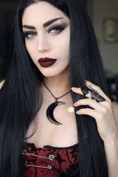 Mahafsoun slays with her 'Luna' pendant and 'Phase' armour ring in black  Conjure yours from www.trickery.com.au  #gothgirl #goth #vampirevibes #vamp #witch #trickeryco #trickery #alternative #accessories