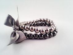 Double charming bracelet with the charming satin bow zł46