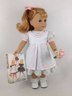 Handmade dress, pinafore, and hair bow for American Girl and other similar 18-inch dolls. Maryellen is modeling my interpretation of a 1950s-1960s pinafore (Butterick pattern #9851 - photo #1 & #5) and a geometric-patterned cotton dress in colors of gray, pink, and white. Dress features include a lined bodice with pink rick rack trim and four pink buttons, a round neckline trimmed in rick rack, puffed and banded sleeves trimmed in rick rack, an inset waistband, and a full gathered skirt....