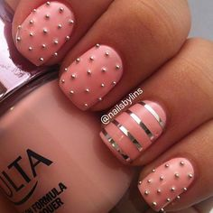 A sassy looking pink and silver themed nail art using silver metallic strips and silver beads as details