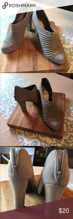 Heeled grey suede boots These cuties should be in your closet! Grey/taupe color.  4in heel with platform. Shoes Ankle Boots & Booties