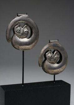 Pre-Columbian, North Coast Peru, Ca. 800-1000 CE.  Set of two silver tweezers depicting flying fox bats