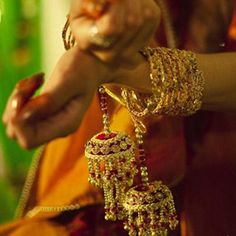 Elegant kaliras with red and gold bead work. Image- Pinterest via Japjit - bollywoodshaadis.com