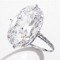 Diamond 'string' ring, JAR, Paris. The oval diamond weighing 16.04 carats, set within a diamond 'string' platinum mounting.