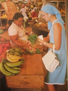Princess Grace shopping in Jamaica for fresh fruit and veggies.  Looking chic and sporting her Hermes bag in white.