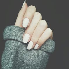 white nails and grey sweather