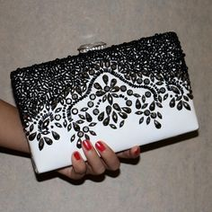 """Jeweled Case Clutch This gorgeous case clutch features black and white leather exterior. Gunmetal and black beaded hardware. Has two chain straps: one that drops at about 5"""" and another drops at about 21"""". Brand new, never used. Priced as marked unless bundled! Bags Clutches & Wristlets"""
