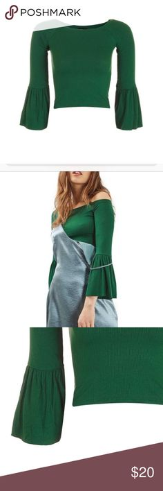 "TOPSHOP Green Trumpet Sleeve Crop Blouse TOPSHOP Green Trumpet Sleeve Crop Blouse - Boatneck - Three-quarter raglan sleeves with flared cuffs - Solid - Cropped - Approx. 14"" length - 93% viscose, 7% elastane Topshop Tops Crop Tops"