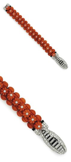AN ART DECO CORAL, DIAMOND AND ONYX BRACLET, BY CARTIER: Designed as three rows of carved coral beads, the top row enhanced by collet-set circular-cut diamonds, joined by a circular and baguette-cut diamond clasp, with onyx detail, circa 1930, 7 1/2 ins., with French assay marks for platinum. Signed Cartier, Paris, with maker's mark, nos. 03353, 03644 and 31-- (partially indistinct). Via Christie's.