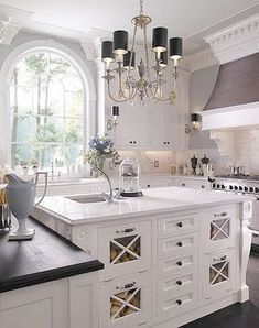 Look at that window!  Gorgeous kitchen...every detail.