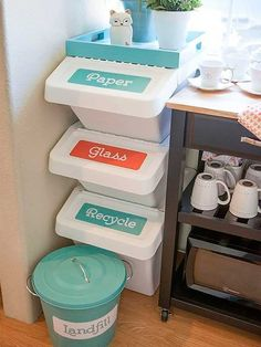 recycling bins in the corner of the kitchen. i believe the bins are from ikea. nice ikea,BUT not as close to the cups