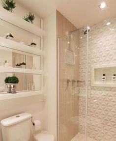 Lindo banheiro com destaque para os Nichos e o revestimento 3D