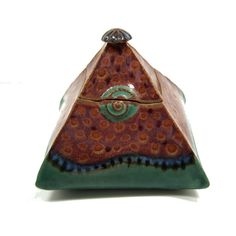Emily's Pyramid Lidded Box - Glazed with Chun Plum dotted with Amaco TH1 Texturizer and Deep Firebrick (lid and top pf box). Pete's Seafoam on base of box, band of Indigo Float, Firebrick dots over,Blue Rutile over the entire band. The inside is the Deep Firebrick which really adds to the overall experience!