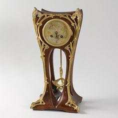 French Art Nouveau mahogany mantel clock / Louis Majorelle