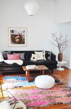 black leather sofa. boho. living room. home decor and interior decorating ideas.
