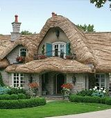 Storybook home plans - build one for yourself! You can even achieve a thatched roof look using steam-bent wood shingles.) Lots of fairy tale cottage styles available. Cute Cottage, Cottage House Plans, Cottage Homes, Cottage Style, Storybook Homes, Storybook Cottage, Fairytale Cottage, Thatched Roof, Thatched House