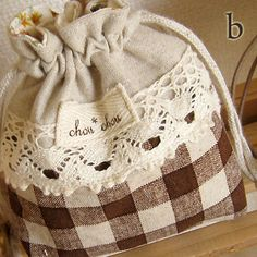 brown gingham drawstring bag with linen and lace embellishment