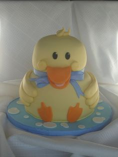 Yellow Duckie - I saw a couple of similar designs in the gallery, but I basically ripped  off Swillshaz's design!  Swillshaz's was too adorable to even think   about making changes.  Thank you for the help too! I was up until  2 am working on this for my nephew's 1st birthday.   I had a little   trouble with getting the beak to stay on, but I really liked the way it   came out.  I had a hard time cutting it up.  This would be cute for a   baby shower too!