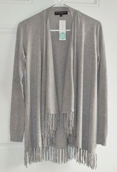 """March 2016 Stitch Fix. Central Park West Bonay Fringe Detail Cardigan in Grey. At the longest point it measures 28"""" and has an incredibly soft 77% Rayon/33% Nylon blend. It drapes beautifully and is so flattering.  https://www.stitchfix.com/referral/4292370"""