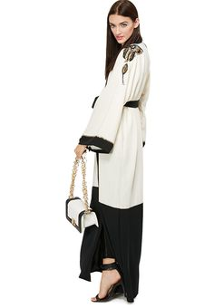 We love this embellished bisht from Haya's Closet for its dual tone blend fabric and bead stud accents. #Namshi #fashion #trendy #monochrome #bisht