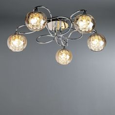 Featuring five clear bauble shades designed with delicate clear glass droplets this ceiling fitting is made with a beautiful woven arm frame with a sleek chrome effect finish. Ikea Bedroom, Laundry Room Organization, New House Plans, Living Room Lighting, Seychelles, Soft Furnishings, Chandelier Lighting, Clear Glass, Plants