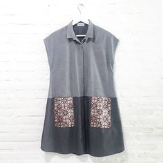 Leona 001  IDR 495.000  Loose Comfy Fit Collared Shirt Dress with Hand Stamped Batik Blouse  Length of Dress : approx. 90 cm  Material Used : Light Jeans Fabric / Hand Stamped Batik, Cotton  Note : Buttons at the front for opening