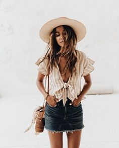 Cute ruffled striped blouse with denim mini skirt and straw hat.