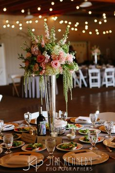 Gorgeous green and pink centerpieces at this Strawberry Farms wedding | red barn wedding | mulberry and moss | Jim Kennedy Photographers