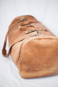 antique brown leather distressed duffle bag~ efficient and strong for travel, but also super cute. It could also be used when just going over to a friend's house:)