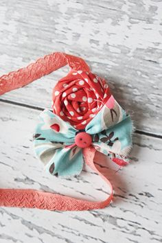 Polka dot and floral rosette and ruffle bow by babybirdieboutique, $15.50