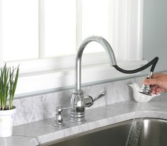 Pull down kitchen faucets from Giagni have a long and curved spout. The nozzle at the end is a separate piece which can be pulled down. This nozzle part also has controlling buttons for aerated stream or full spray options.