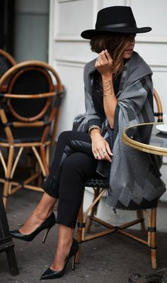Zoé Alalouch wears stylish grey cape with her black cigarette trousers and simple heels.   Cape // Top // Trousers: Le temps des Cerises.