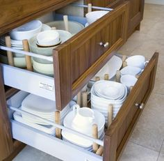Deep drawers w/ adj pegs for dishes