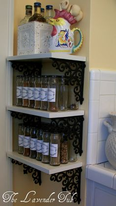 Accessible Spice Rack  -brackets from Hobby Lobby, notches in shelves to fit around the door facing, jars are from Hormel Bacon Bits! the spice label frame graphic can be found at the Graphics Fairy